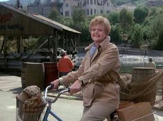 """Jessica on Her Iconic Bicycle in Cabot Cove. """"Murder, She Wrote"""" TV Show on CBS (1984 - 1995) charming author Jessica Fletcher (Angela Lansbury)."""
