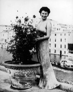 Peggy Guggenheim on her Venice terrace, wearing a Fortuny Delphos gown, 1950's.