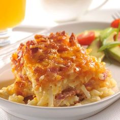 POTATO BACON BREAKFAST CASSEROLE  Ingredients:  4 cups frozen shredded hash brown potatoes;  1/2 cup finely chopped onion;   8 ounces bacon or turkey bacon, cooked and crumbled;  1 cup (4 oz.) shredded cheddar cheese;  1 can (12 fl. oz.) * NESTLÉ® CARNATION® Evaporated Milk;  1 large egg, lightly beaten or 1/4 cup egg substitute;  1-1/2 teaspoons seasoned salt