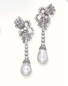 A PAIR OF PEARL AND DIAMOND EAR PENDANTS  Each designed as a baguette and circular-cut diamond ribbon top to the circular-cut graduated tassel suspending a drop-shaped pearl, measuring approximately 11.25 - 12.10 x 18.35 and 11.40 - 12.35 x 16.80 mm., with a baguette-cut diamond cap, mounted in platinum. With certificate 39654 dated 15 July 2002 from the SSEF Swiss Gemmological Institute stating that the pearls are natural saltwater pearls