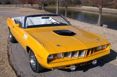 yellow 71 Cuda... and a convertible no less!  Who could ask for more?