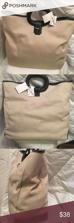 MAXX NY handbag Tags still on!  Beautiful beige rough linen like material with black leather trim. Flowered lining has a side pocket and attached zippered pouch. MAXX NY Bags Satchels