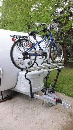 I just ran across this option that I hadn't seen before. It's a tongue-mounted bike rack designed specifically for travel trailers.