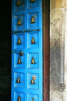 Blue door with bells, Sri Chakrapani Temple, Kumbakonam, India
