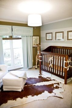 This is almost exactly how I envision my sweet baby boy's room. Most specifically, the cowhide rug!