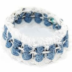 Denim bracelet  looks like its frayed, then rolled into beads and strung on thread for soft bangle