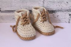This Baby Hiking / Combat boot pattern is a super modern crochet design, and will be adored as a gift - find the pattern on LoveCrochet!