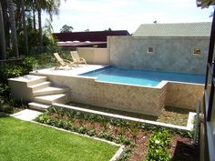 Semi-inground pools are becoming a sought after design choice for many new pool owners. A semi-inground pool allows people to be more creative with their design. Small Swimming Pools, Above Ground Swimming Pools, Swimming Pools Backyard, Swimming Pool Designs, Above Ground Pool, Pool Landscaping, In Ground Pools, Backyard Pool Designs, Small Backyard Pools