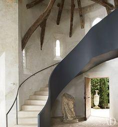 sculptural staircase of steel balustrade; 17thc Italian nail studded walnut front door