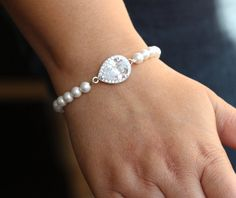 Bridesmaid/Mothers bracelet inspiration  (Except with heart charm and blue/orange crystals)
