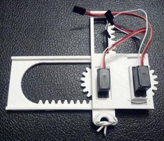 Create drawing robot with 6 plastic 3D printed parts, 2 micro servo motors, a rubber band and a pencil. So simple! See the design iterations further down the page. It now has 3 axes with 8 parts and can use WaterColorBot's code.