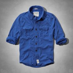 Button-down chest pockets, reinforced stitching, heritage logo patch at center placket near hem, Vintage Abercrombie Wash, Muscle Fit, Imported<br><br>60% cotton / 40% polyester