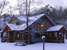 small timber frame homes - Google Search  reminds me of the classic lodge we had our <3's set on for years...love the porches