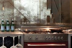 Antique, patina mirrors make for an unexpected backsplash