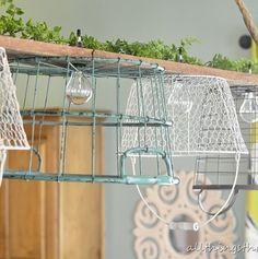 Wire basket chandelier. Too cute.
