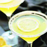 A deliciously sweet lemon martini made with limoncello, vodka, sweet and sour mix, and a dash of lemon. Dress it up with lemon-flavored sugar along the rim! Vodka Martini, Vodka Cocktails, Easy Cocktails, Alcoholic Drinks, Lemon Drop Martini, Sour Mix, Winter Cocktails, Cocktail Making, Limoncello