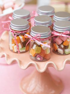 Candy Jars Tiny jars and bulk candy is the foolproof recipe for a favor that is a crowd pleaser.