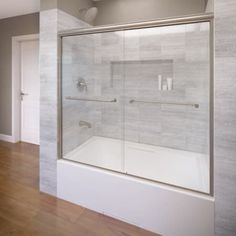 Basco Infinity H x to W Semi-Frameless Bypass/Sliding Brushed Nickel Bathtub Door at Lowe's. A Basco Infinity glass tub enclosure proves that less is more with its frameless bypass glass panels. The quarter-inch thick glass features polished edges Bathtub Doors, Frameless Shower Doors, Bathtub Tile, Small Bathroom, Master Bathroom, Bathroom Ideas, Bathroom Stall, Bathroom Tubs, Condo Bathroom