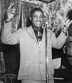 """""""Sugar Mama"""" John Lee """"Sonny Boy Williamson"""" was one of the Godfathers of the Blues. His unique style of Blues harp still stands out. In the 30′s, Sonny Boy was a driving force in electrifying the Blues. Muddy once said that; """"the Blues had a baby, and they called it Rock-and-Roll"""" – Sonny Boy was the daddy."""