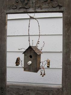 bird house hung inside old frame <3