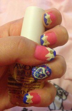 Pink and blue bow nail art