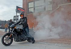 A Harley-Davidson employee removes a brick from the historic Milwaukee headquarters using a 2015 Harley-Davidson Street® 750 motorcycle. In the spirit of this year's 75th Sturgis Motorcycle Rally, that brick, alongside one from the Harley-Davidson Museum and 73 bricks from the headquarters' famous motorcycle-only parking area, will be incorporated into the design of a new permanent plaza built by Harley-Davidson on Main Street in Sturgis, S.D.
