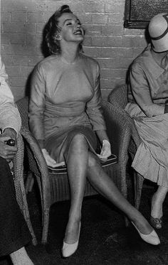 Marilyn at a press conference on her arrival in England, July 14, 1956.