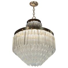Mid-Century Modernist Cut Crystal Triedre Camer Chandelier with Brass Fittings | From a unique collection of antique and modern chandeliers and pendants  at https://www.1stdibs.com/furniture/lighting/chandeliers-pendant-lights/
