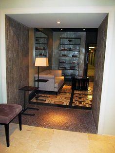 Tile a passageway between rooms to fancy it up.