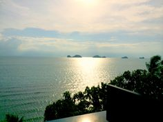The fabulous view of the sunset over the Gulf of Thailand waters and the iconic 'Five Islands of Koh Samui' in the distance at a villa at Conrad Koh Samui