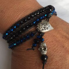 """3X Wrap Leather Swarovski Skull Bracelet Black/Blu 3X Wrap Leather Swarovski Skull Bracelet Black and Royal Blue AB Crystals with a pewter heart button. The Blue crystals have a purpose hue at the center, which is absolutely stunning when the light hits it just right. Measures 21"""" from button to loop closure. My wrist is just over 6 1/4"""" and it fits loose but comfortable. Please measure your wrist. If over 7"""" this will not fit. (This is custom made - No Brand Name) Jewelry Bracelets"""