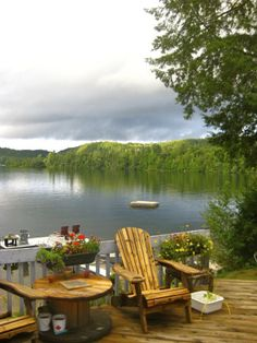 Cottage country! Wooden spool table, a couple of Muskoka chairs and bug spray. Enjoy...