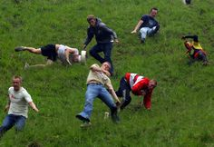 "Cheese Rolling at Cooper's Hill. Cheese Rolling at Cooper's Hill. ""Cheese Rolling at Cooper's Hill"" Go Cheese, Festivals In England, Uk Bucket List, Cheese Rolling, British Summer, Weekend Deals, Thing 1, Festivals Around The World, United Kingdom"