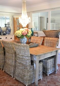 Love the texture the wicker chairs add (though they seem cumbersome) and the shutters dividing the rooms