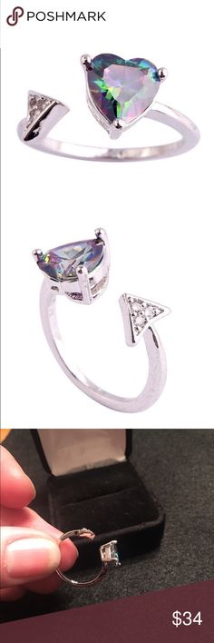 Heart to Arrow Sterling Silver Mystic Topaz Ring Mystic or Rainbow Topaz heart shaped center stone in Sterling silver with white Topaz arrow. Open ring. Can be used as a midi ring. Jewelry Rings
