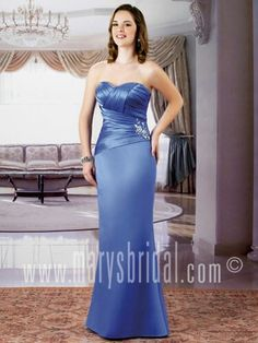 Asymmetrical pleated bodice with slightly flared skirt