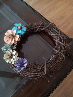 Painted pinecone flowers on a grapevine wreath