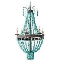 A rustic take on a lighting classic, this is a swag chandelier with a twist -strung with turquoise beads over a rough textured iron base. Perfect for lodge, Spanish Revival and vintage inspired places, the cool stone and warm light of 8 bulbs will most certainly be a conversation starter.