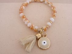 New for SS 2016 Gorgeous Beige Handmade Evil Eye Stretch Tassel Beaded Bracelet Greek Mati by ForThatSpecialDay on Etsy