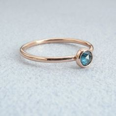 Gorgeous blue diamond and rose gold ring.