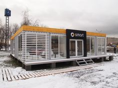 The pavilion design idea was to create a mobile platform for carrying out promotional activities in the warmer months and demonstrate the possibilities of a compact car Smart. Interior design concept was to use as basis the pavilion several cargo containers, which are partly glazed.