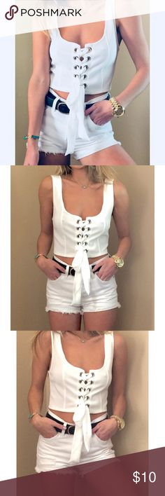 Sexy lace up white crop top New without tags. Super sexy white lace up crop top Forever 21 Tops Crop Tops