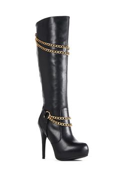 Vamp it up in Vaynas. She's a super sexy tall heeled boot with gold chain and O-ring detail and a hidden platform. Faux leather, zip back....