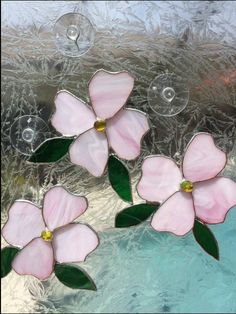 This lovely stained glass dogwood blossom is an original design. It is the state flower for North Carolina and Virginia. From my Nature collection: You can add a touch of spring now with this beautiful spring Dogwood flower. Hang it in your window against the white snow background to