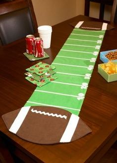 Football Table Runner - Kick off the big game day party by decorating your snack table with a football theme table runner. The center of the runner is designed to look like a football field and is completed by two giant footballs on each end. Football Crafts, Football Themes, Football Banquet, Football Field, Football Favors, Football Decor, Football Parties, Football Stuff, Football Season