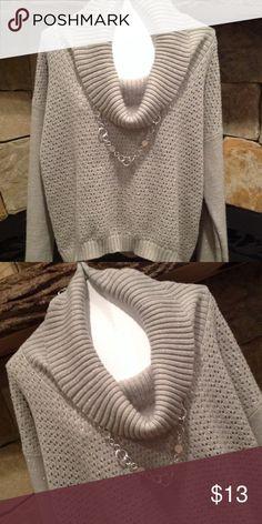 Silver Metallic cowl neck sweater Hi low hemline, metallic thread throughout,92% acrylic, 5% polyester, 3% other fibers, long sleeve Metaphor Sweaters Cowl & Turtlenecks
