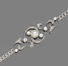 A diamond and pearl bracelet, circa 1890  The late 19th century central cartouche of scrolling openwork design set throughout with old brilliant and rose-cut diamonds, to a central bouton-shaped pearl, to a curb-link bracelet strap, later rhodium plated, diamonds approx. 1.00ct total, pearl untested for natural origin, length 18.0cm, fitted case by Catchpole & Williams