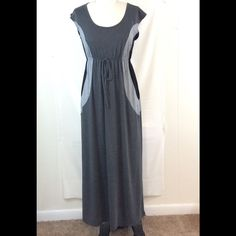 """Gray and Black Short Sleeved Maxi Medium Great fall maxi, gray and black with short sleeves. Has elastic and a tie at the waist. Shoulder to hem is 52.5"""". Excellent condition. Dresses Maxi"""