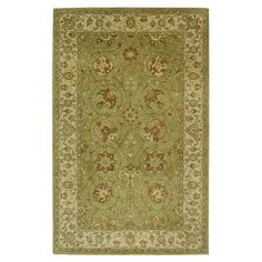 Hand-tufted wool rug with a Persian-inspired floral motif and sage palette.  Product: RugConstruction Material: 100% ...
