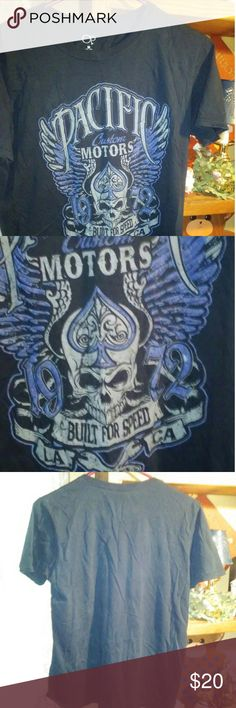 """⚠⚠ Women's medium Op t-shirt⚠⚠ This dark blue t-shirt has the words """"PACIFIC Custom MOTORS and BUILT FOR SPEED"""" around a skull, blue wings (on each side of the skull), 2 wrenches at the bottom of the picture- resembling cross and bones-. It has the year 1972 on it with LA and CA. The design has a embossed velvety feel. It is 100% cotton. Op Tops Tees - Short Sleeve"""